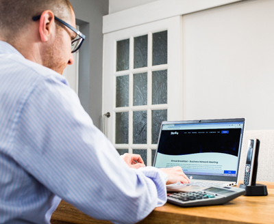 man working at computer for the purpose of reviews